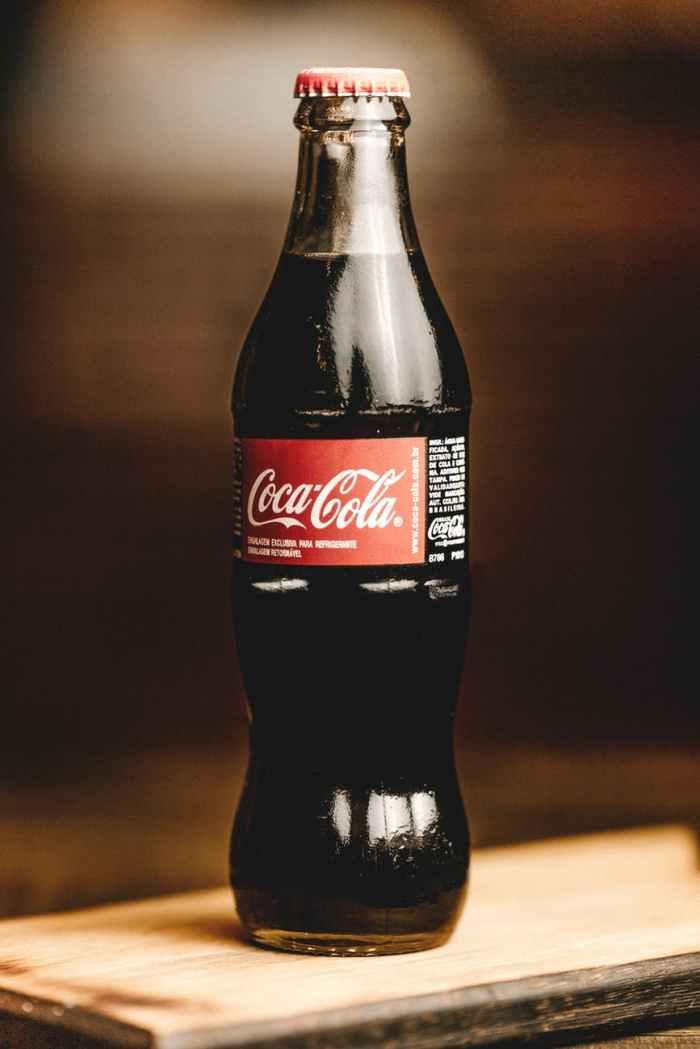 coca cola glass bottle macro photography