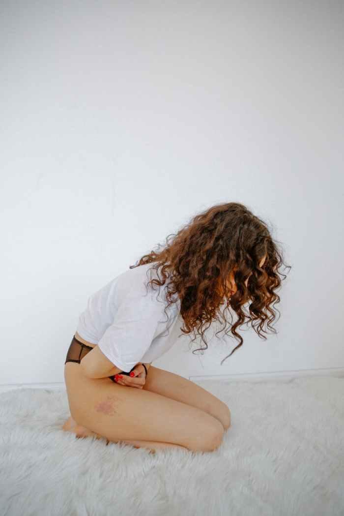 woman having painful cramps
